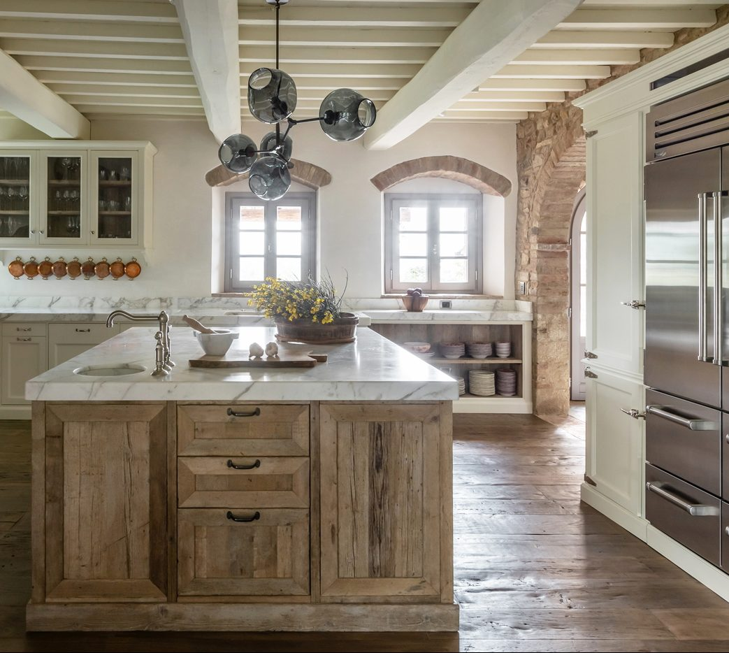 Rustic Italian Villa kitchen with island and light fixtures