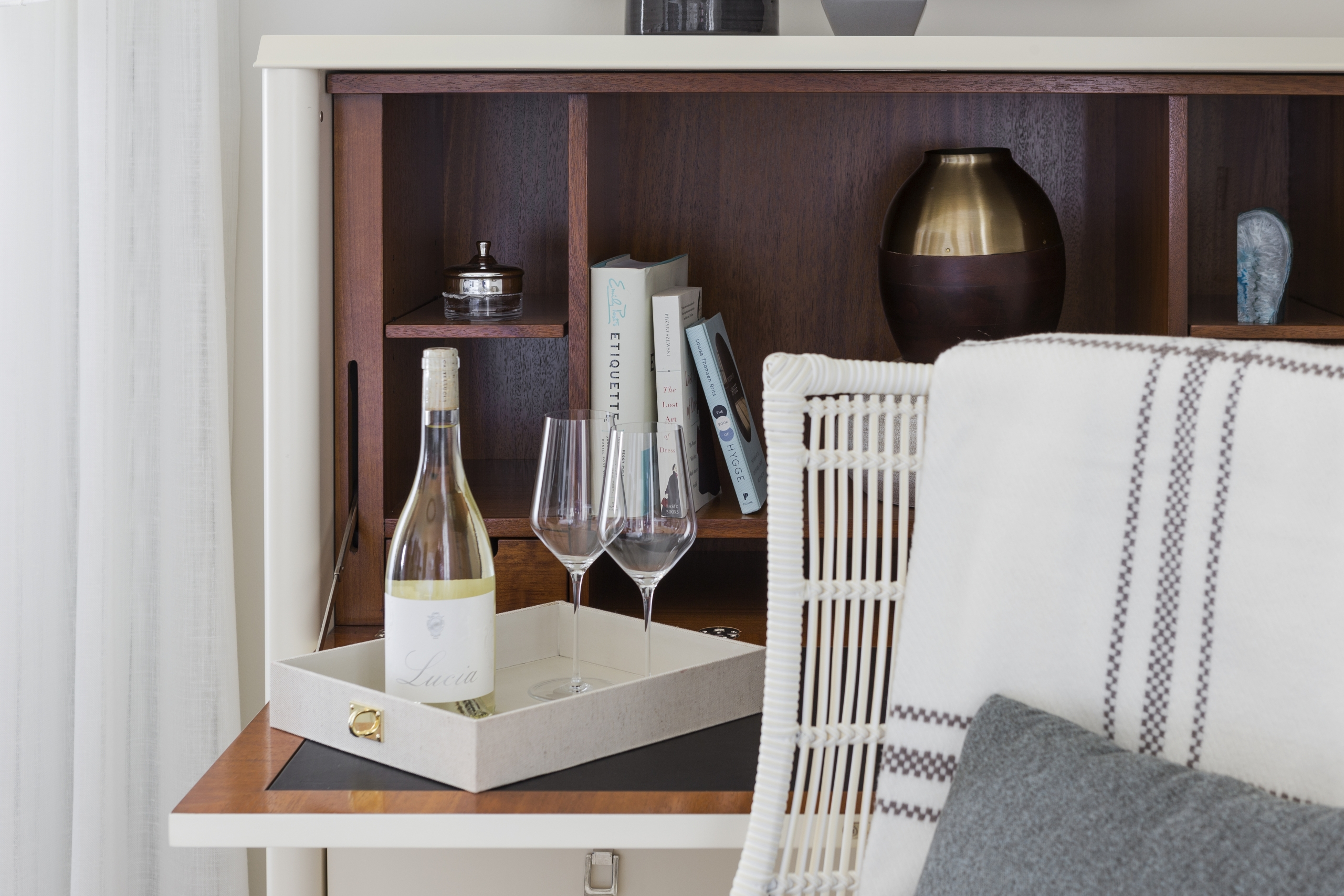 Bedside table with champagne and bookshelves