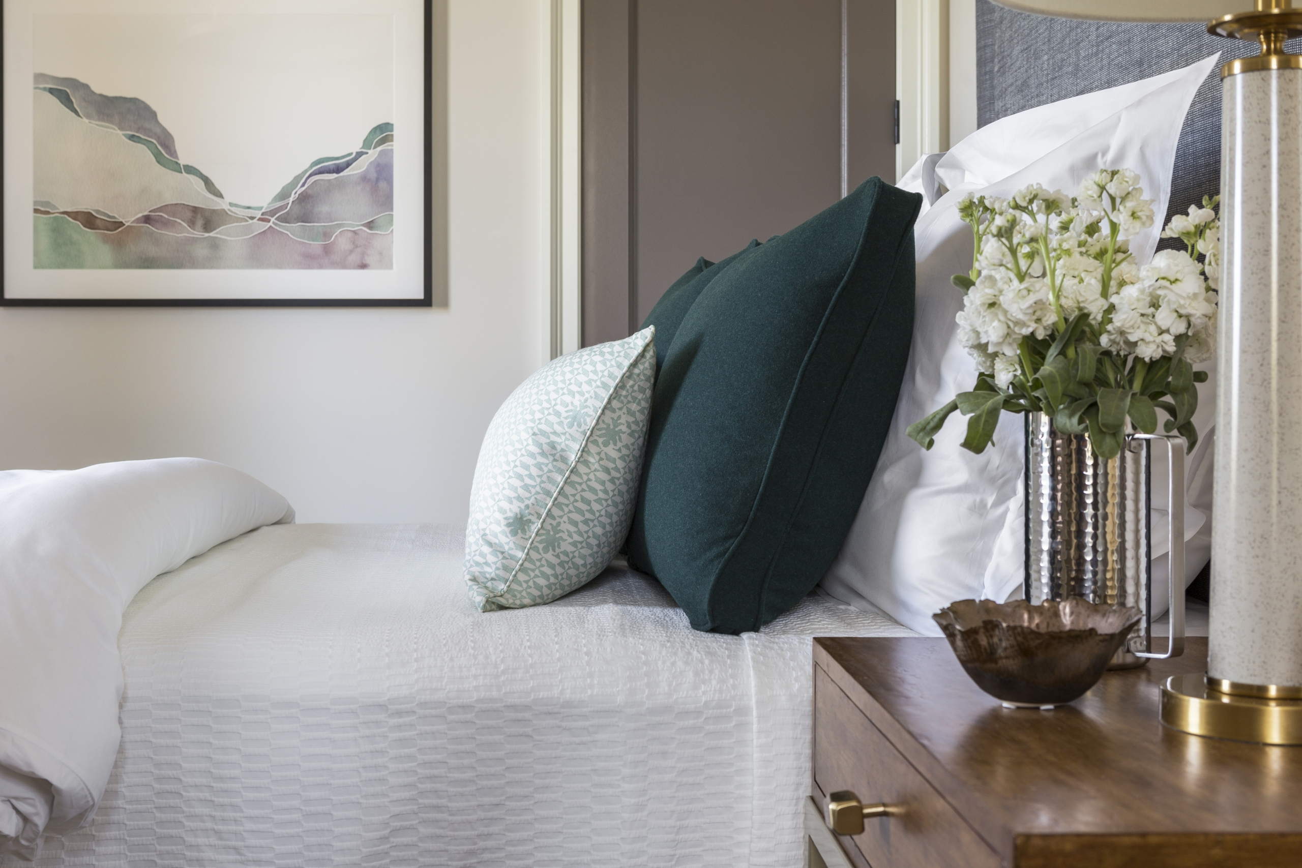 custom headboard with green pillows designed by Sarah Lawson