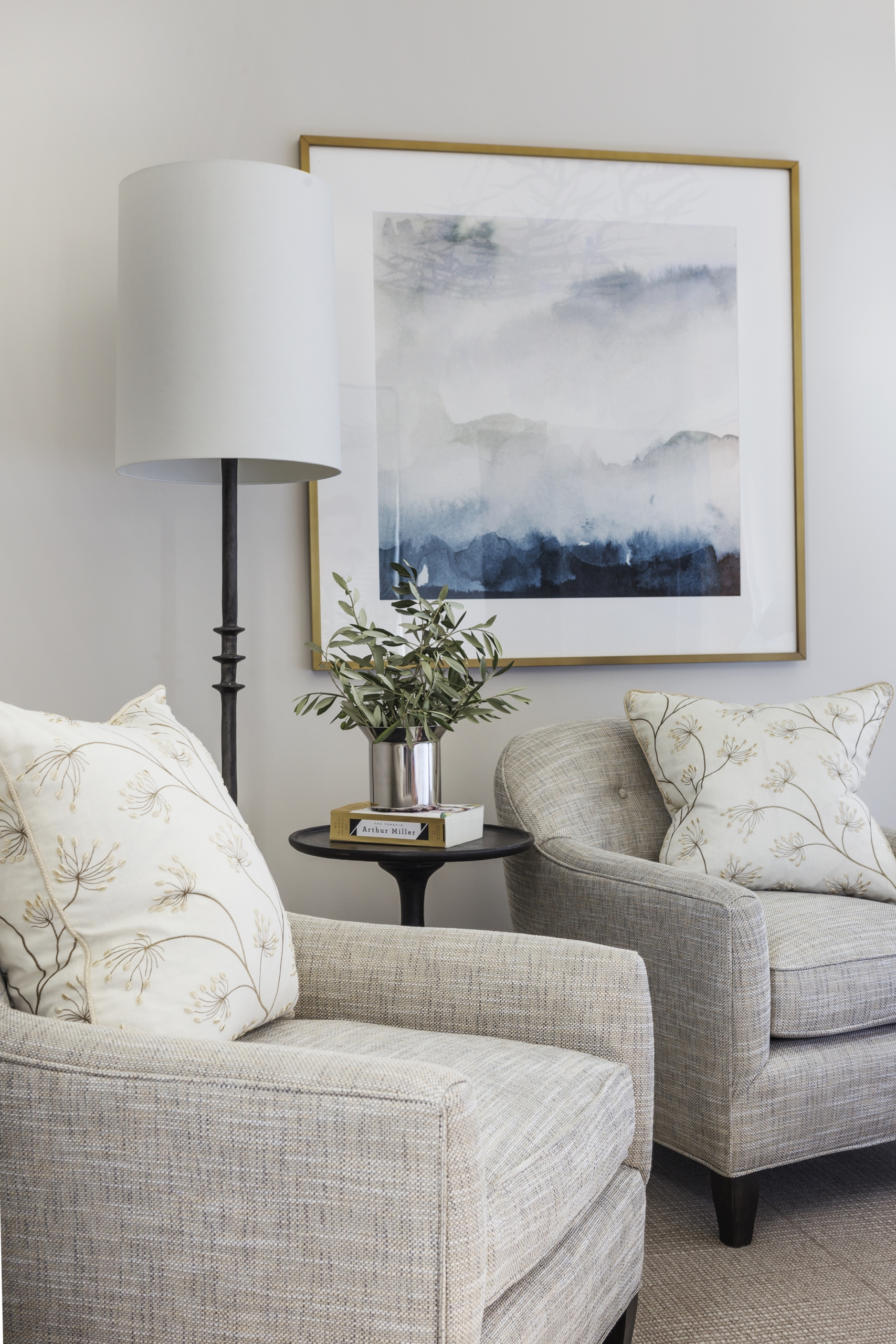 St Helena Boutique sitting room with absract art, chairs, and lighting