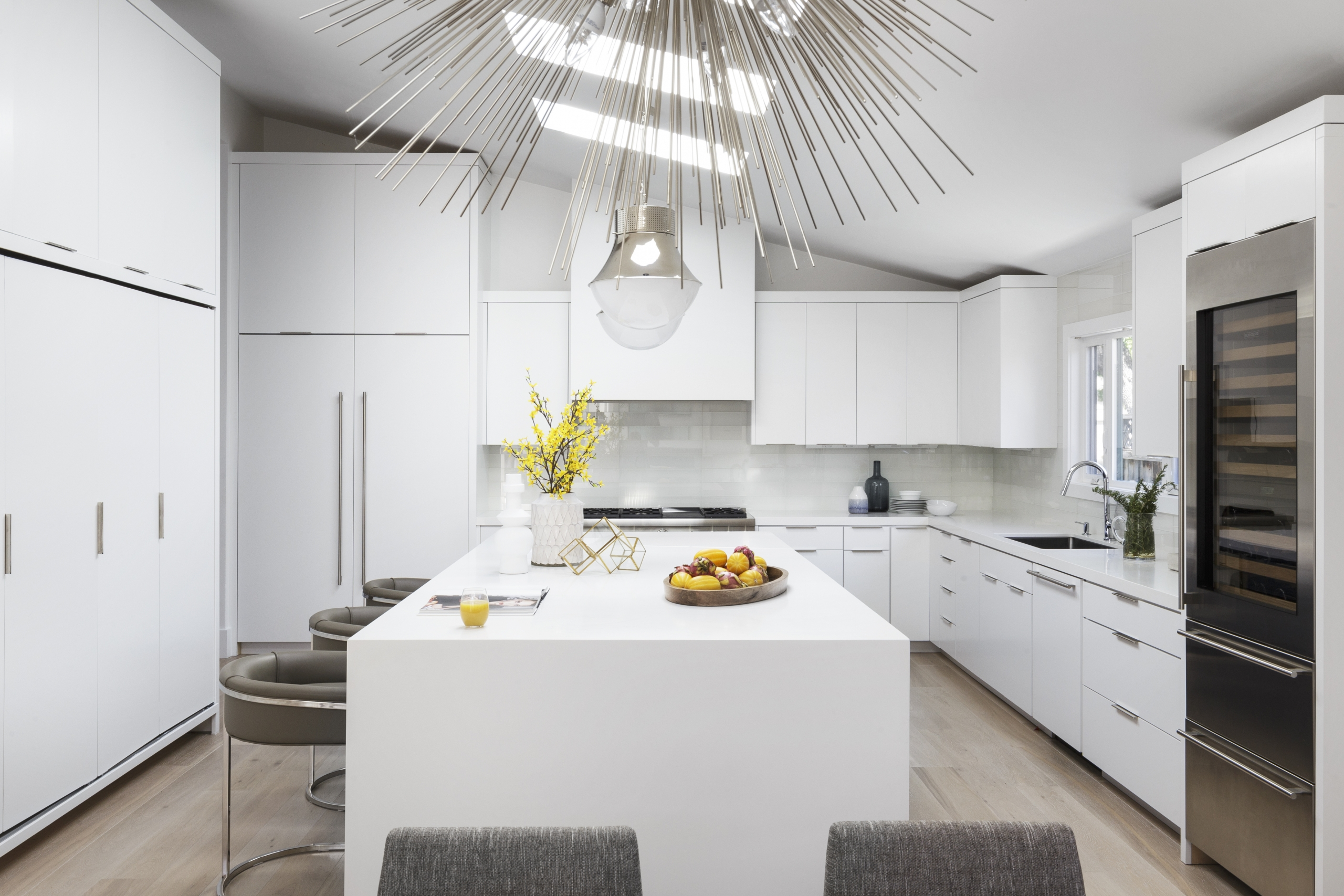 Kitchen with modern pendant, scaled lighting, and contemporary design