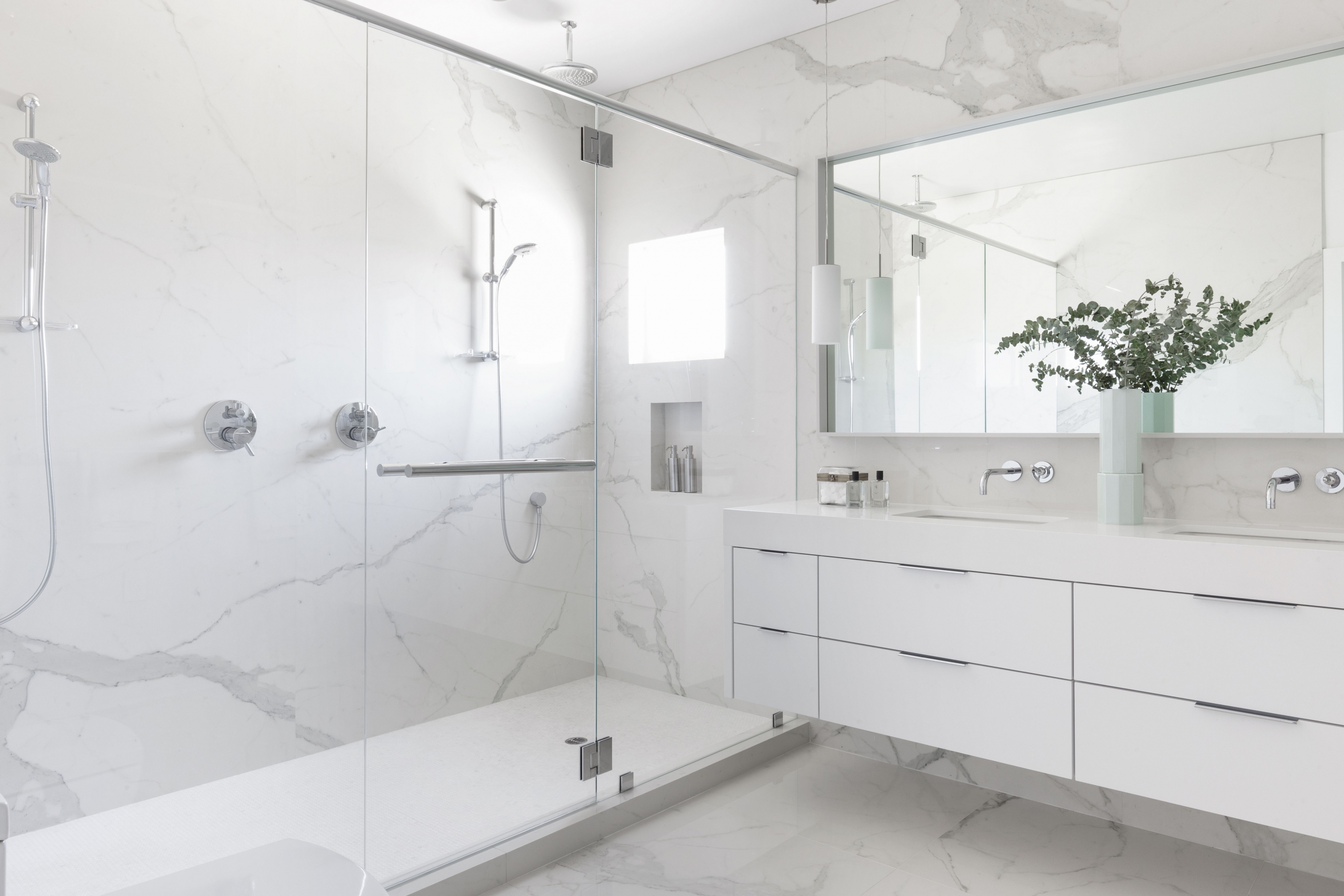 What bathroom with lower mirror and vase
