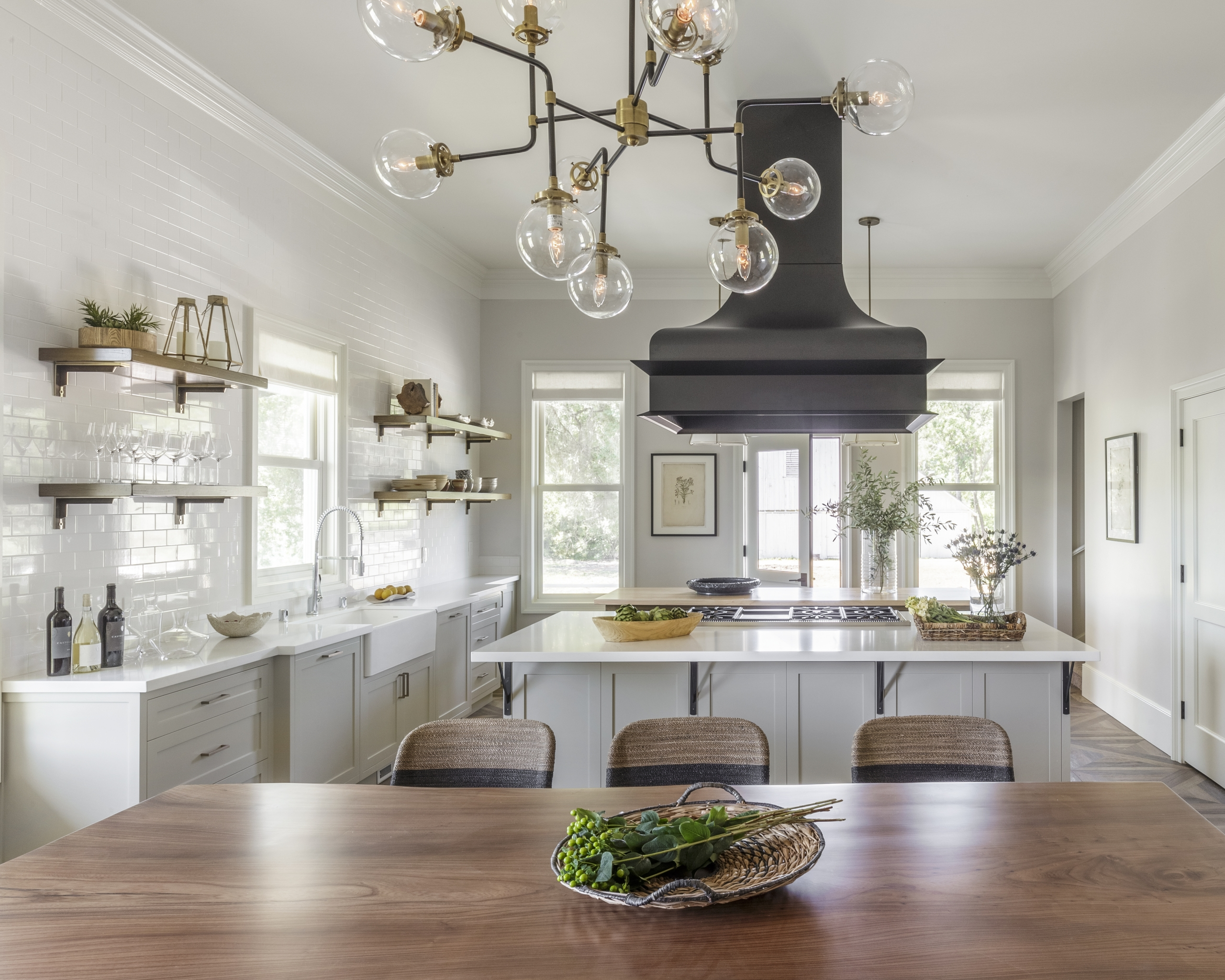 Kitchen with dining table, chandelier and island